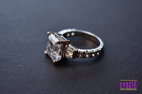 Magnificent step-cut fancy ring.