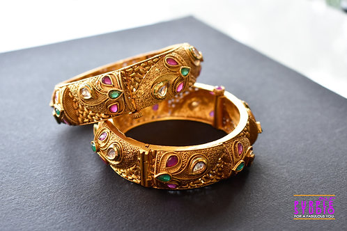 Sophisticated Pair of Golden Bangles with Green and Pink Stones