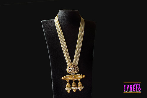 Gorgeous Golden Kundan Set in Pearl Setting