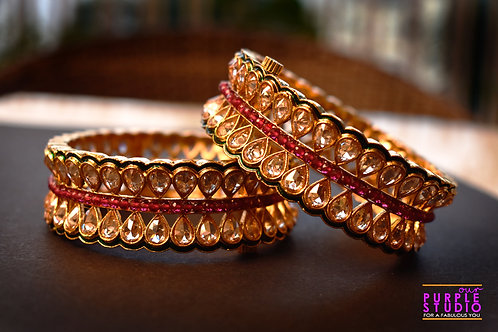 Sophisticated Pair of Golden Kundan Bangles in Pink Stones