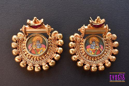 Mesmerizing  Golden Danglers with beautiful Radha Krishan Embossing