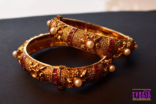 Sophisticated Pair of Golden Bangles with Pink Stone and Pearl