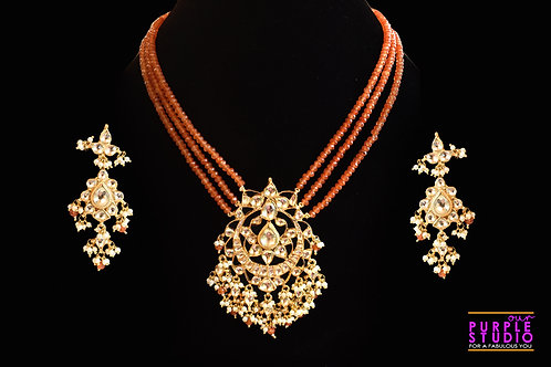 Sophisticated Semi Precious Kundan Necklace Set  in Rust Beads