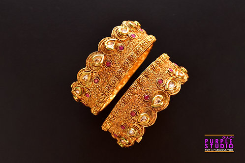 Sophisticated Pair of Golden Bangles with Pink Stones