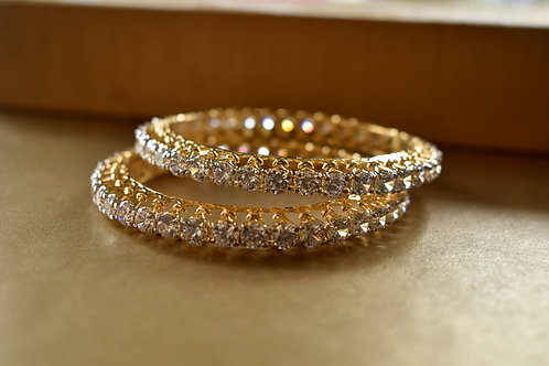 Sophisticated Pair of  white  AD Bangles in Golden Polish
