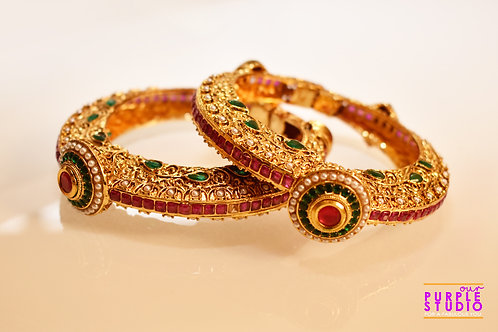 Sophisticated Pair of Golden Bangles with beautiful Pink Semi Precoius Stones