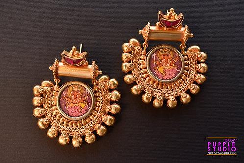 Mesmerizing  Golden Danglers with beautiful Ganeshji Embossing