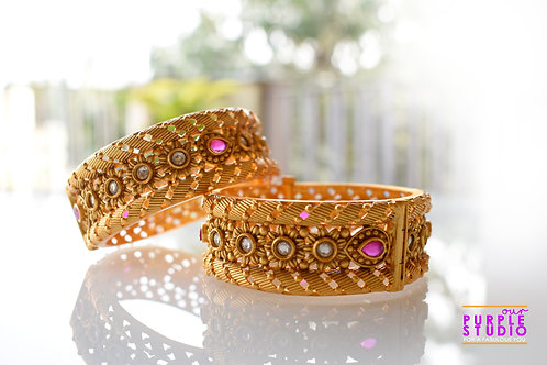 Sophisticated Pair of Golden Bangles with Kundan Stones