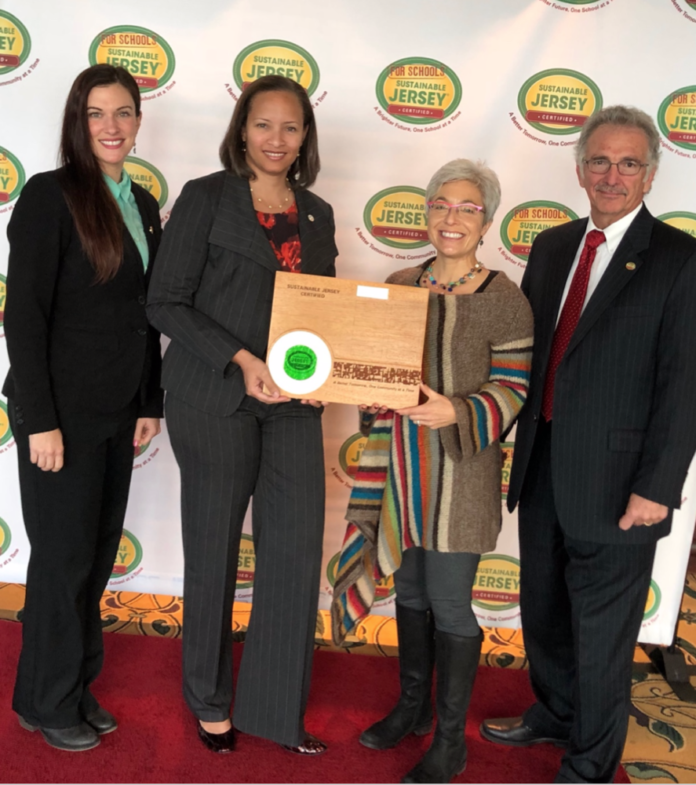 From left: Lauren Cranmer, president of Sustainable Morristown; Jillian Barrick ,Town administrator; Rebecca Feldman, Morristown program coordinator; Ed Russick, Sustainable Morristown trustee.