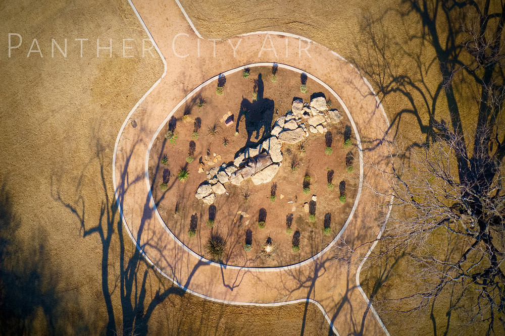 Aerial view showing the original casting of Riding into the Sunset, depicting Will Rogers on Soapsuds shown in the shadow, located in Amon Carter Square at WRMC