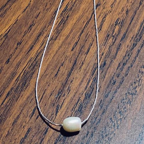 Plata líquida con perlas