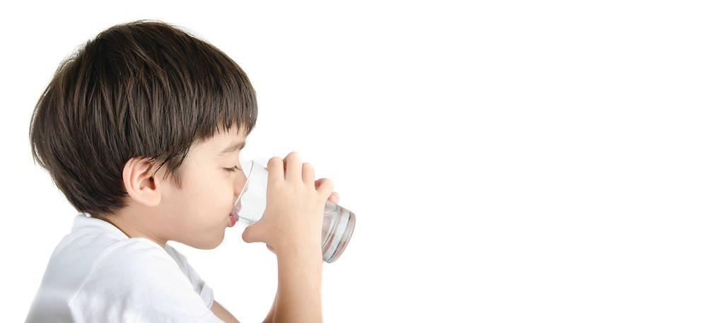 A little boy Drinking Jantzen Water