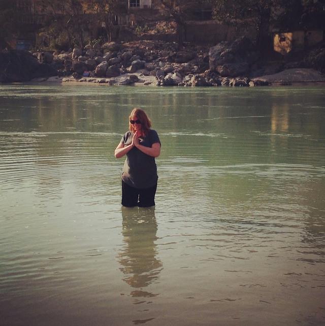 girl standing in river
