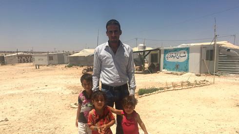 Adel and children, Zaatari refugee camp Jordan