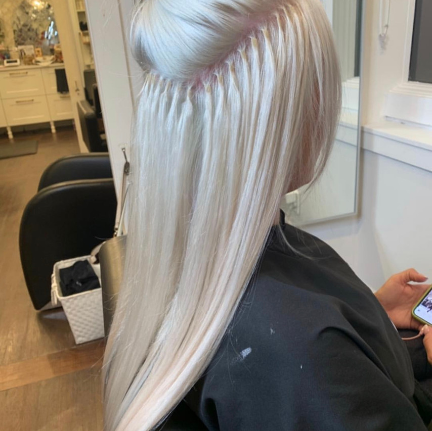 We added a full head of keratin bonded extensions