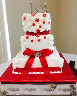 Wedding_Cake_red_white_rosettes_bow_broa