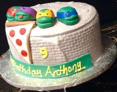 Kids_Cake_ninja_turtles_sewer_heads.jpg