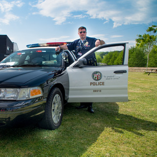 American Cop Car and Officer.jpg