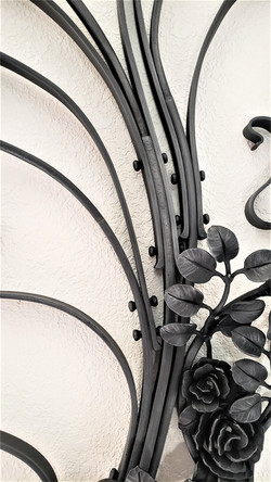 """Iris and rose grille, forged and fabricated mild steel, 24"""" x 60"""", detail"""