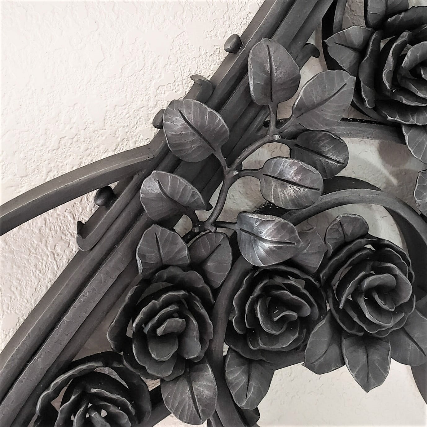 "Iris and rose grille, forged and fabricated mild steel, 24"" x 60"", detail"