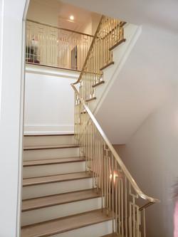 polished brass handrail