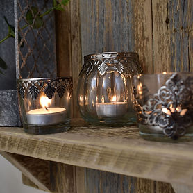 Group of Tealights on Wooden Shelf