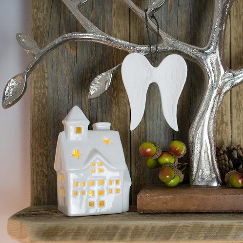 White Ceramic LED House on Shelf with Ornaments