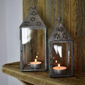 Nordic Lanterns on Wooden Shelf