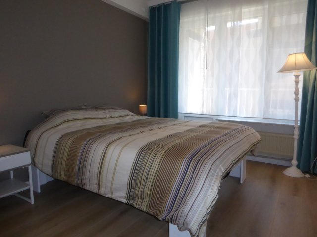 grote slaapkamer met terras