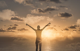 young woman acting the golden sunrise feeling inspired and happy. .jpg