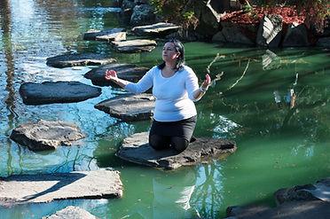 woman meditaing in lake