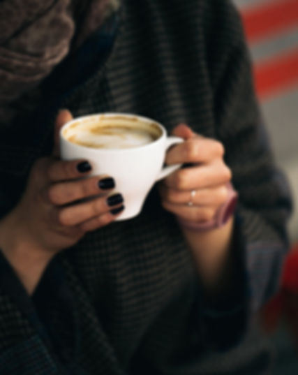 Woman%20Holding%20Coffee%20Cup_edited.jp