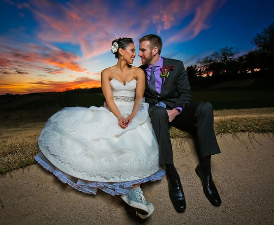 Bride and groom stare deeply into each other's eyes at sunset