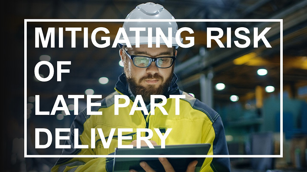 "White bolded test that says ""Mitigating Risk of Late Part Delivery"" while a man wearing a engineering suit looking at a tablet"