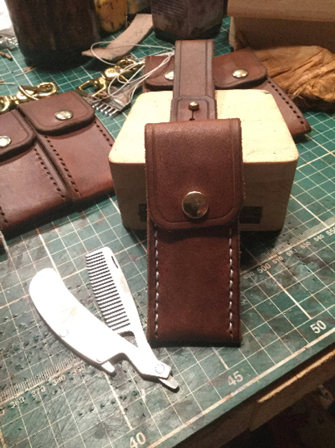 Straight Razor style moustache comb in a leather pouch