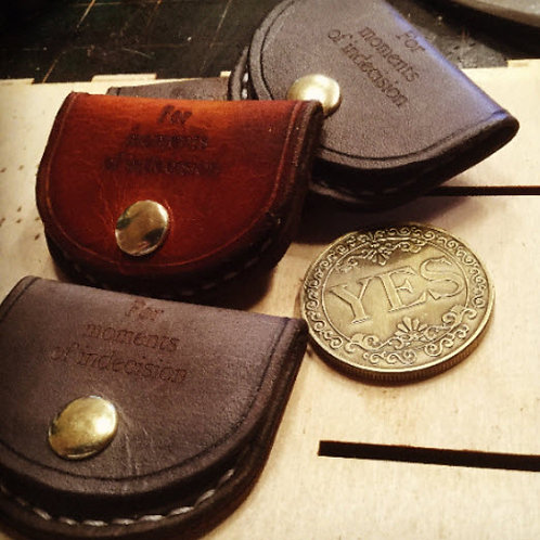 Decision making coin in a hand sewn leather pouch.