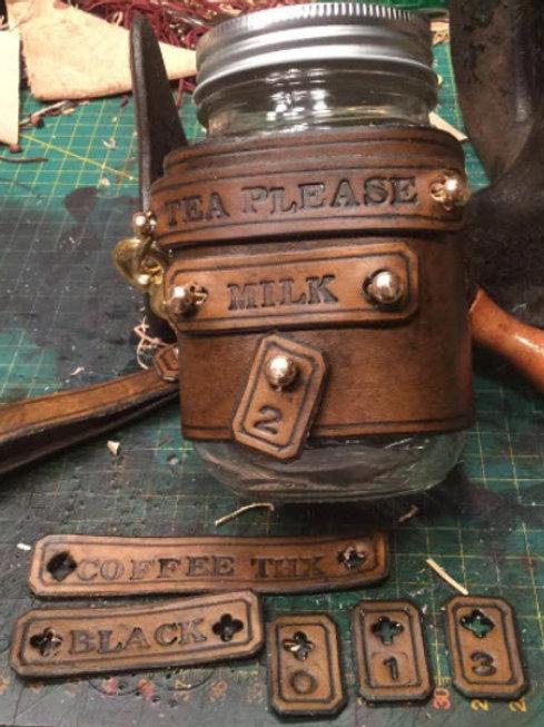 Adaptable Steampunk style mason jar mug cozy made from full grain veg tan leathe