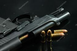 depositphotos_1336073-stock-photo-black-gun-and-bullets