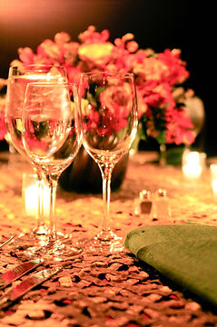 Photograph of 3 glasses on a table at an event.