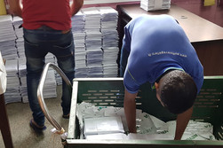 Packaged book being stacked for stamping