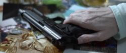 Gun on table