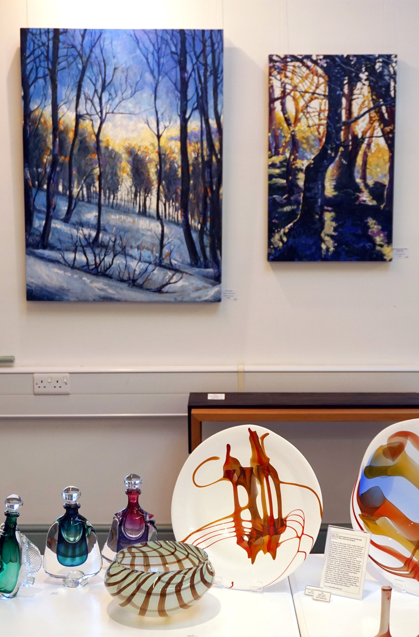Snowy Hillside and Bluebell Sunrise. In the foreground is some wonderful and beautiful glass by Karlin Rushbrooke.