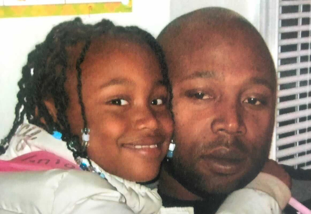 Taniah pictured with her father while she was in kindergarten.