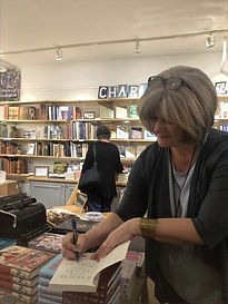 Signing-with-bookshelves-e1574477234726_