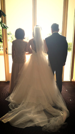 walking their daughter down the aisle at Torrey Pines Hilton - San Diego Day Of Coordinator