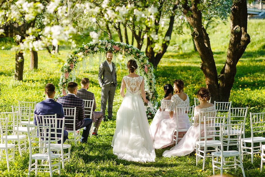 Wedding ceremony in the apple orchard in