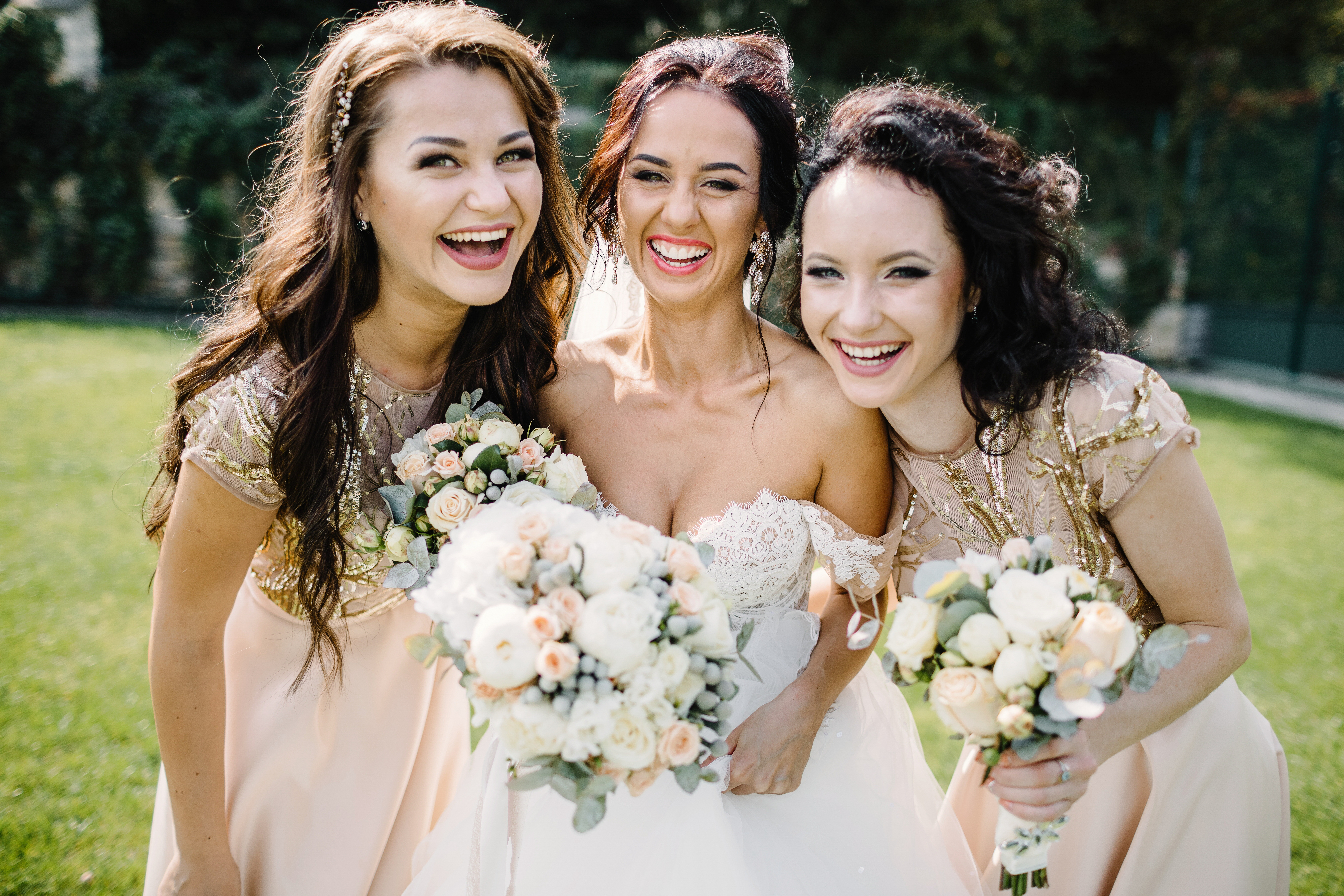 Laughing bride and bridesmaids tell funn