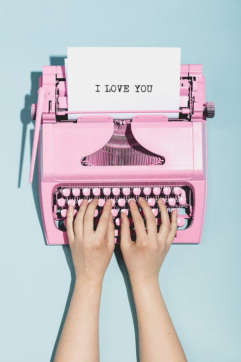 """Woman's hands writing """"I love you"""" on an"""