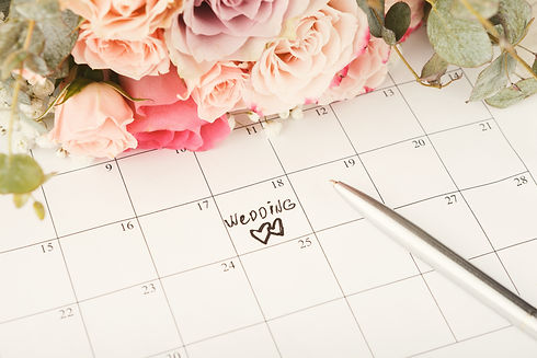 Word wedding and two hearts on calendar