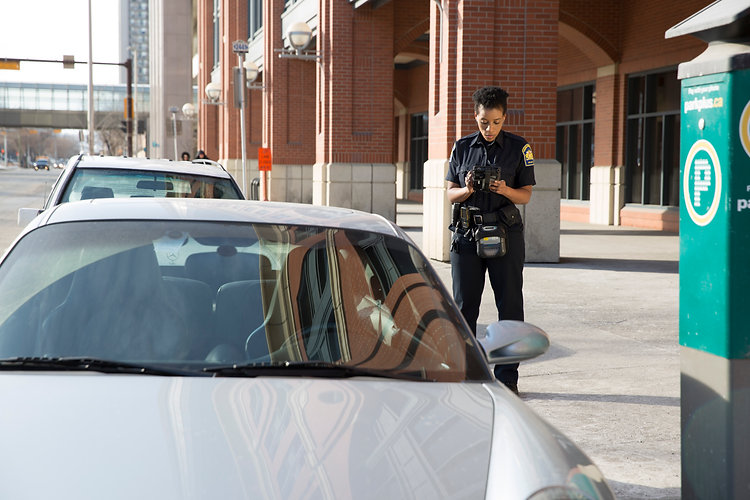 Parking Enforcement Officer issuing a ticket